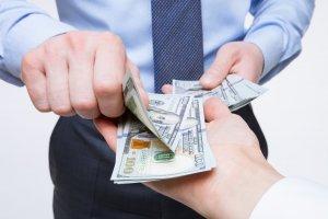 Man handing over money - law of recuperation